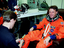 Astronaut Michael Foale suits up before the STS-103 launch.