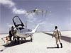 A man standing near a plane in the salt flats looking at a plane flying in the sky