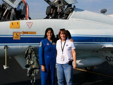 Diedre Adams and Suni Williams in front of a T-38 airplane