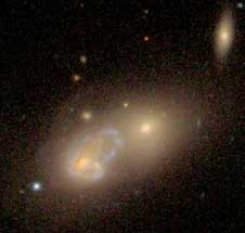 This image from the 2m telescope at Kitt Peak National Observatory in Arizona shows NGC 1142, an active galaxy undergoing such a collision.