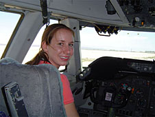 Lawson sits in an aircraft pilot's seat