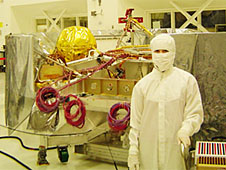Lawson wears a cleansuit in front of the cruise stage of the Mars Science Laboratory spacecraft