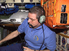 ISS012-E-21181 -- Bill McArthur talks on station ham radio.