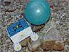 A balloon-powered rover climbs over a rock