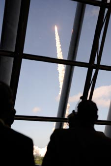 Shuttle launch as seen from inside the Firing Room in the Launch Control Center