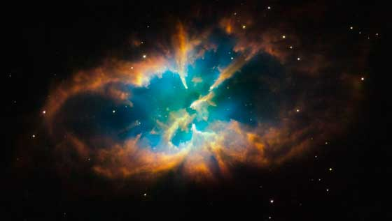 NASA - Hubble Snaps Images of a Nebula Within a Cluster