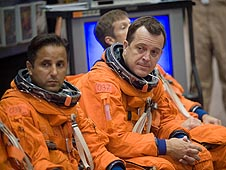 Joseph Acaba and Richard Arnold wearing training versions of their orange launch and landing suits