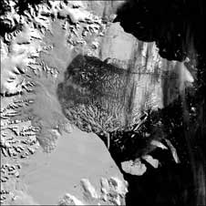 The northern section of the Larsen B ice shelf, a large floating ice mass on the eastern side of the Antarctic Peninsula, shattered and separated from the continent on March 5, 2002, and  represents a major impact that climate warming can have on the region.