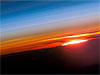 The setting sun photographed from the International Space Station