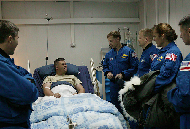 STS-126 Crew with wounded soldier