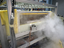 Nitrogen vaporizes as engineers remove environmental chamber doors after a test