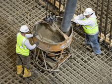 Workers mix concrete