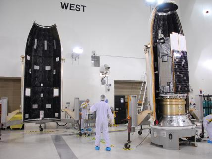 The Orbiting Carbon Observatory spacecraft is installed in the payload fairing