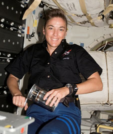S115-E-07274: Astronaut Heide Stefanyshyn-Piper with Yeast-Group Activation Packs