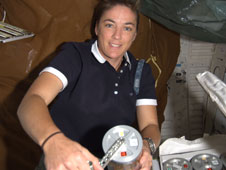S126-E-008302: Astronaut Heide Stefanyshyn-Piper with Microbe Group Activation Pack