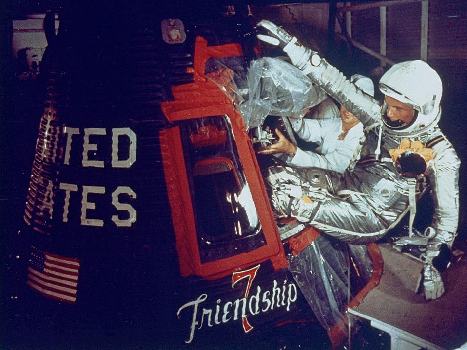 On Feb. 20, 1962 at 9:47 am EST, Glenn launched from Cape Canaveral's Launch Complex 14 to become the first American to orbit the Earth. In this image, Glenn enters his Friendship 7 capsule with assistance from technicians to begin his historic flight.