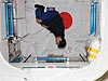 Japan Aerospace Exploration Agency astronaut Takao Doi is suspended in midair inside the space station