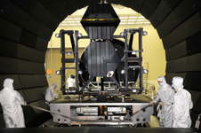 Technicians prepare JWST mirrors for testing in a vacuum chamber.