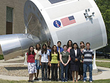 Students standing in front of a spacecraft mock-up