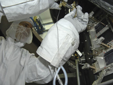 Hubble astronaut Andrew Feustel performs a tool evaluation for the repair of the Advanced Camera for Surveys instrument. He is shown here inside the large clean room at NASA's Goddard Space Flight Center during a March 12 training session.