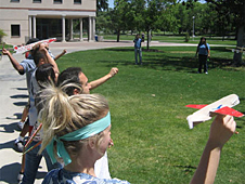 A line of teachers ready to fly small glider airplanes