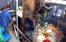 Engineers run tests on a ground-based, sun-observing instrument.