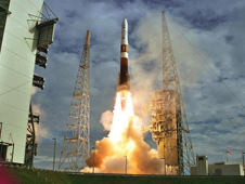 A Boeing Delta IV rocket launching GOES-N satellite into space.