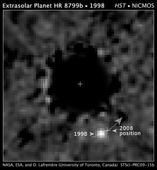 Hubble Space Telescope NICMOS (Near Infrared Camera and Multi-Object Spectrometer) coronagraphic image of a planet orbiting the star HR 8799