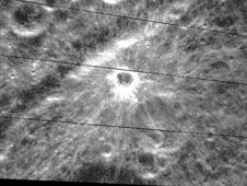 A very young, fresh impact crater (3 km diameter) on the western limb of the Moon near the crater Sylvester.