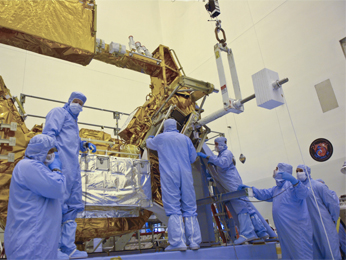 Goddard engineers and technicians install the replacement SI C&DH onto the Multi-use Logistics Equipment (MULE) Shuttle carrier