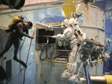 STS-125 EVA crew member practices SI C&DH task at Neutral Buoyancy Laboratory in Houston, TX.