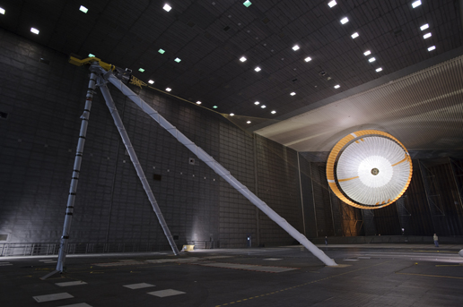 Image shows the parachute for NASA's Mars Science Laboratory passing flight-qualification testing in March and April 2009 inside the world's largest wind tunnel.