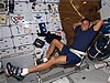 Acaba on a space shuttle exercise bike