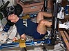 Archambault works out on exercise equipment inside the space station