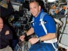 Hobaugh on an exercise bike inside the space station