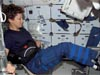 Collins on a space shuttle exercise bike
