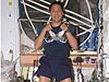 Astronaut Edward Lu wearing an exercise equipment shoulder harness inside the space station