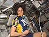 Sunita Williams sits on an exercise bike inside the space station