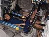 Wakata works out on exercise equipment inside the space station