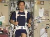 Lu on a treadmill inside the space station
