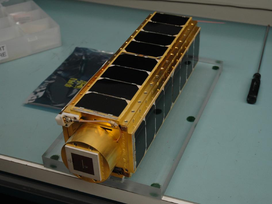 The satellite payload sits fully assembled, covered in shiny solar panels (NASA/ARC/Christopher Beasley)