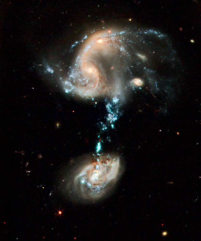 """Arp 194. This interacting group contains several galaxies, along with a """"cosmic fountain"""" of stars, gas, and dust that stretches over 100,000 light-years. Image and caption courtesy NASA."""
