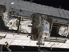 Two astronauts on a spacewalk outside the space station