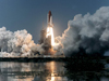 Space shuttle Atlantis launches from Kennedy Space Center.