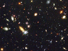 "Several hundred never before seen galaxies are visible in this ""deepest-ever"" view of the universe, called the Hubble Deep Field (HDF) in 1996."