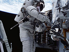 Astronaut works on Hubble.
