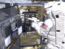 Artist depiction of an astronaut working on Hubble