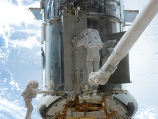 Astronauts perform upgrades on the telescope during a spacewalk in the 2002 servicing mission