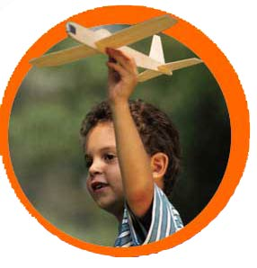 Little boy flying cardboard airplane