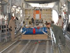 NASA and ATK test engineers at the US Army's Yuma Proving Ground prepare for the first test of all three Ares I main parachutes.